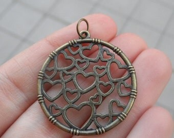 4 Charms Circle with Hearts Color Antique Bronze