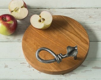 Circular Metal and Wood Cheese Board with Hand Forged Iron Handle and Solid Cherry Hardwood.