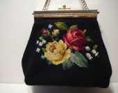 Needlepoint purse trimmed in brass with chain handle in silver
