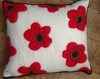 Wet Felted Poppy Cushion with machine embroidery and beading.