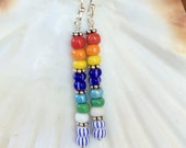 Colorful African trade Christmas beads dangle from sterling earwires.