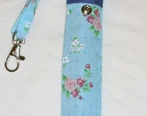 hand made  blue with rose  print   electronic-cigarette  (e-cig) case or pouch.  with belt loop and trigger clip