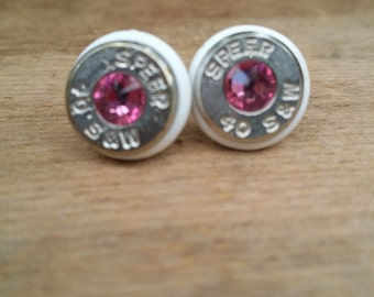 white and pink .40 caliber stud earring with color ring
