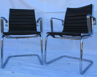 A set of eight eames style chairs made by high end Italian maker Luxy