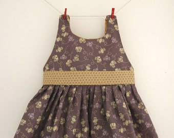 Chocolate bee dress with gold lined top and honeycomb band and bow.