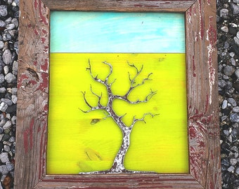 metal tree sculpture with handmade rustic frame. repurposed material