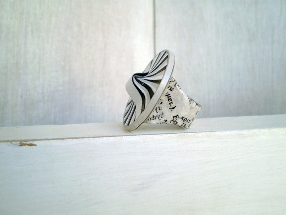 https://www.etsy.com/listing/219421249/round-modern-ring-o-black-grey-white