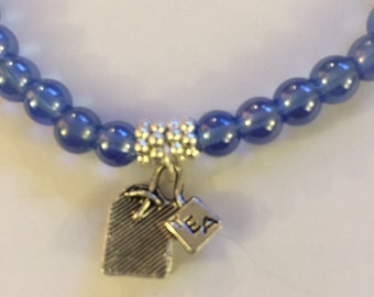 Tea lovers charm bracelet with periwinkle glass beads