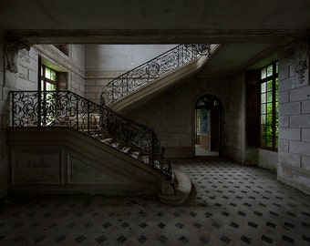 Chiaroscuro photography of stairs in an abandoned castle in France