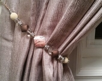 Beaded drapery tie-back with cream, silver, brown & pinky beads on copper wire. Stylish and glam for your curtains!