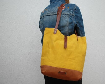 Tote bag waxed canvas,yellow color, leather base with  handles and closures in leather