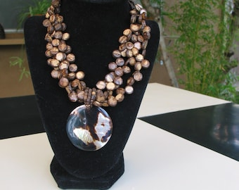 Gorgeous Vintage Flat Brown Bead Necklace Accented With Tigar Shell.