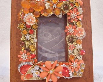 Wood and Gold Tone Photo Frame with New and Vintage Jewelry in Shades of Citrus Orange.