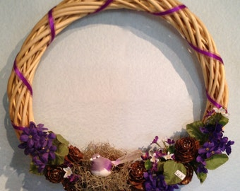 Natural Cane Wreath with Rich Purple Blosoms, Pine Cone Flowers, a Purple Bird and Lavender Bow Exclusive Home Decor from Crafts by the Sea