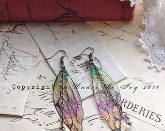"Pretty ""New"" faerie wing earrings"