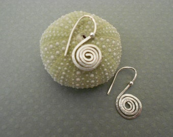 Sterling Silver Twist hoop earrings with silver ball accent