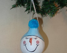 Gourd art hand painted snowman ornament with blue toboggan and pom pom by Debbie Easley