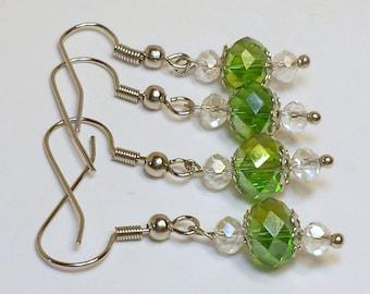 Dangle Earrings White/Clear Crystal and Green Crystal beaded dangle earrings.Light weight Less than an inch long. Beautiful little earrings.