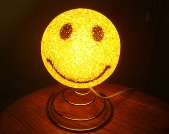 A Cute Retro Yellow Happy Face Lamp.