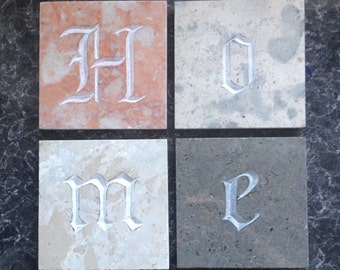 "Hand-Cut Portuguese Stone Coasters spelling ""HOME"" unpainted."