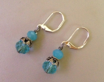 Earrings in antique silver with blue beads and lever back wires.  AS0113