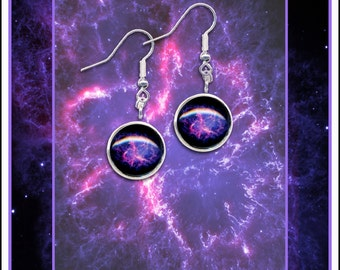 Sterling Silver purple Crab Nebula  earrings on a greetings card with envelope