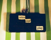 Original 'Relax and Play' Blackout Poetry Art Necklace/Pendant