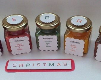 Set of Christmas candles. Square, screw top jars, with a variety of wax and Christmas scent combinations!