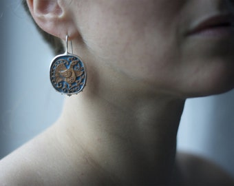 Handmade ceramic earrings in silver 999  frame.