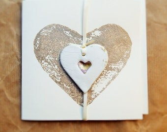 Card with cream and gold removable ceramic heart charm
