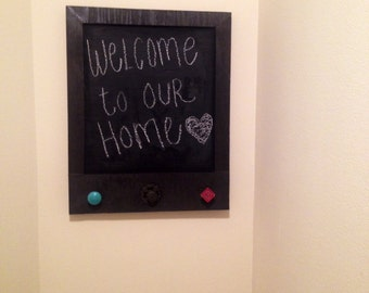 Rustic wood finished chalkboard with decorative knobs