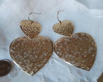 Bold, gold metal heart earrings