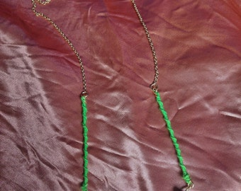 Pearl necklace with glass beads and green accents.