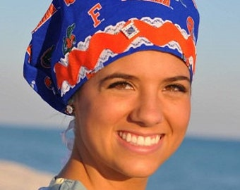 Women's scrub hat made from Gator Blue Univ of Florida fabric with Lace and Ric Rac trim