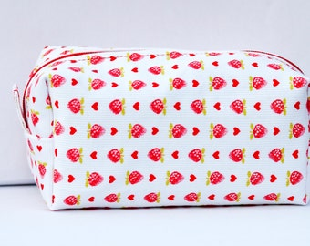 White beauty-case with strawberries and hearts