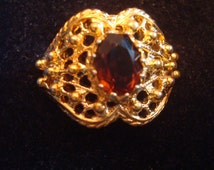 Signed Vargas  18 KT H.G.E. Oval shaped  Amber Stone Ring
