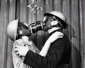Reproduction Photograph Kissing Gas Masks Mistletoe Black and White Man and Woman Wartime