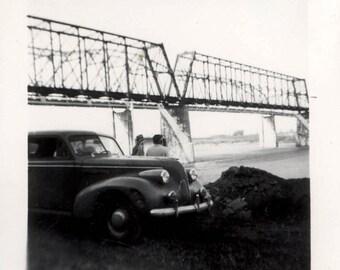 vintage photo Couple and 1940s Car Park by Missouri River Bridge