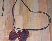 2 faux embossed copper pendants