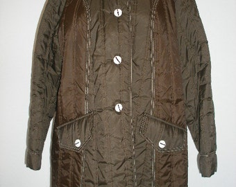 70s women's quilted coat. Brown quilted fabric coat, mod-esque, knee length overcoat in brown with white top-stitch.