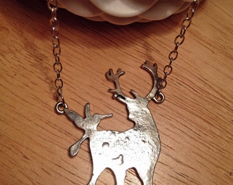 Silver deer pendant necklace on a silver plated chain