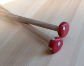 Red and white dotted Size 11 knitting needles