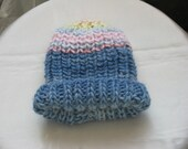 Knitted hat for toddler in english patent pattern wool an acrylic in blue shade and pastel colors