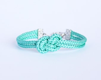 Turquoise blue infinity knot nautical rope bracelet with silver or gold anchor charm