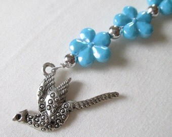 Blue phone charm with bird charm. Aqua and silver.