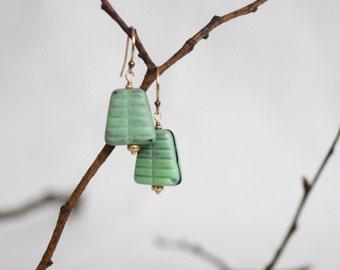 mod earrings in matte green pressed glass . berlin