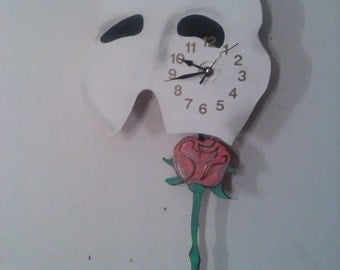 Phantom of the Opera pendulum clock with swinging rose