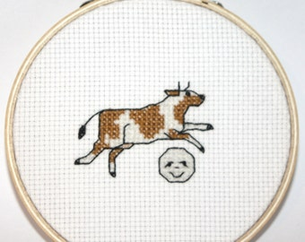 The Cow Jumped Over the Moon Cross Stitch (finished and framed in embroidery hoop)