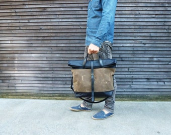 "18"" waxed canvas bag carry all / messenger bag with leather fold to close top, and adjustable shoulderstrap UNISEX"
