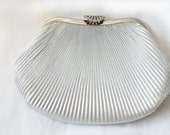 Vintage 1950s silver lamé evening clutch with flip closure and long chain